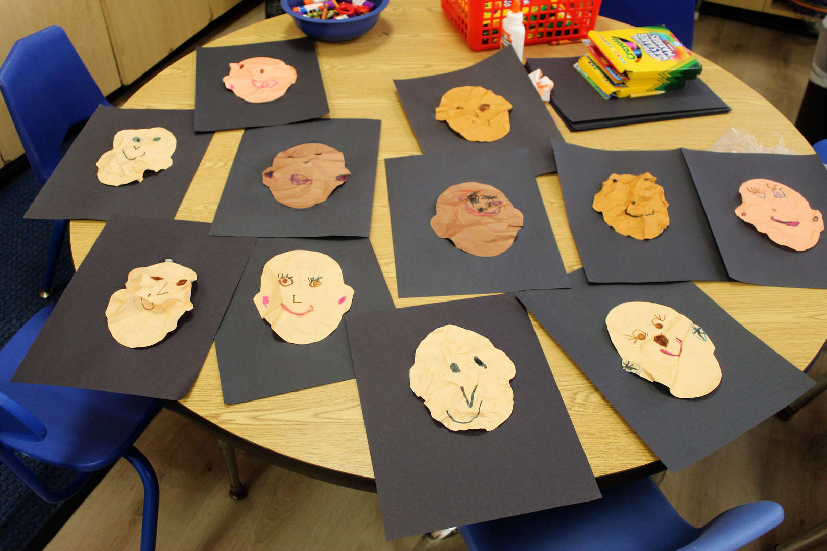 "Pre-kindergarteners created self-portraits with paper they crinkled up to ""age"" their faces."