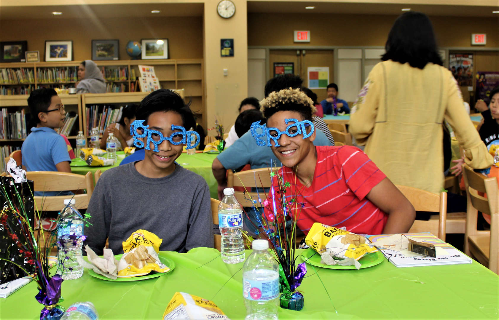 Eighth-graders showed off grad glasses they received at the luncheon.