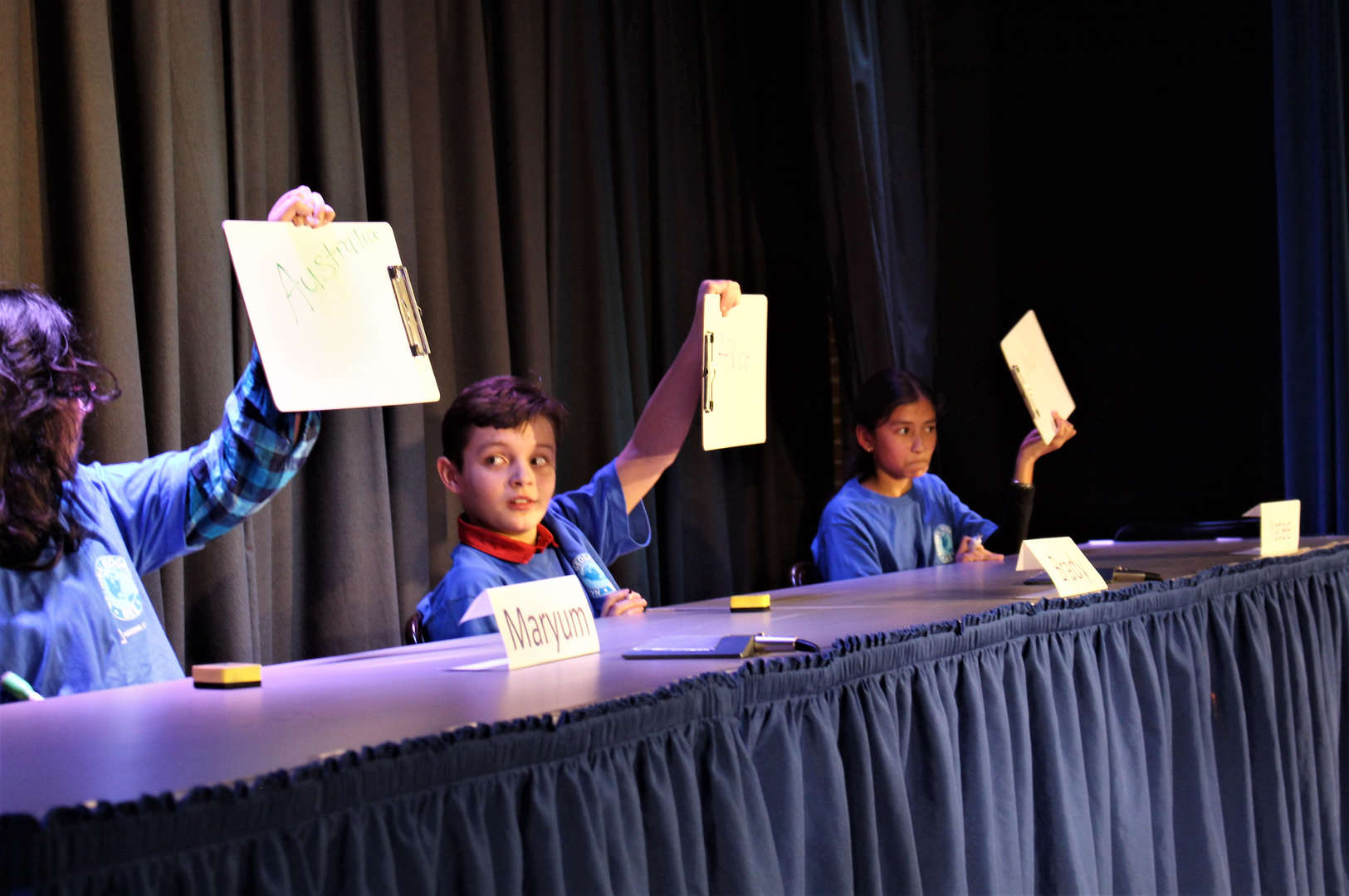 GeoBee contestants share their answers with the audience.