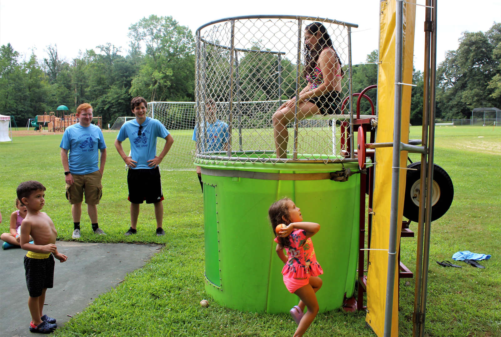 Campers trying to dunk a staff member at Pocantico.