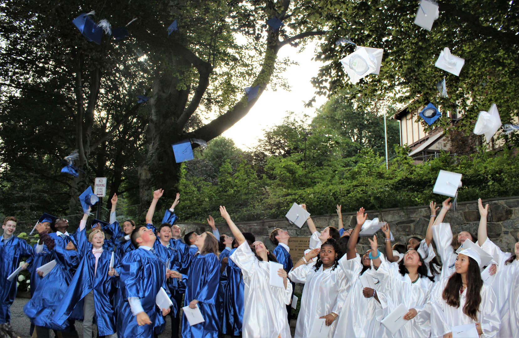 Eighth-graders throw up their caps after graduating from Pocantico Hills School.