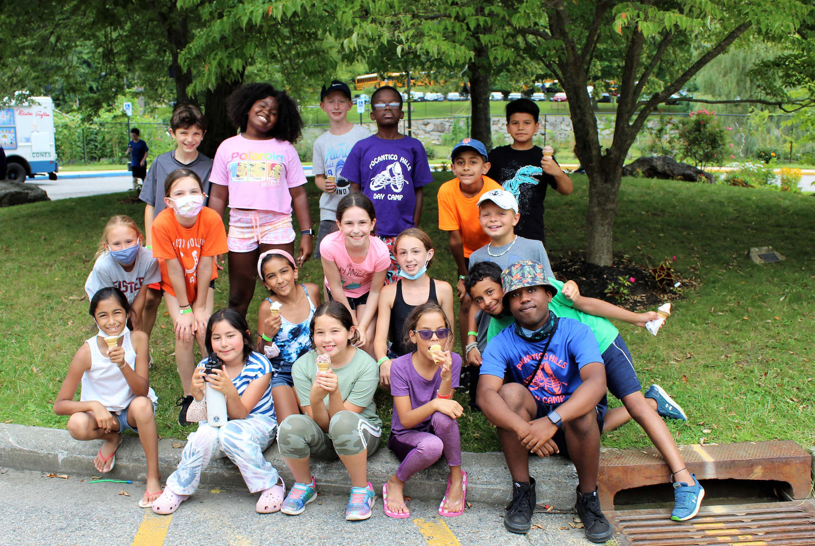 Campers and a camp counselor pose for group photo.