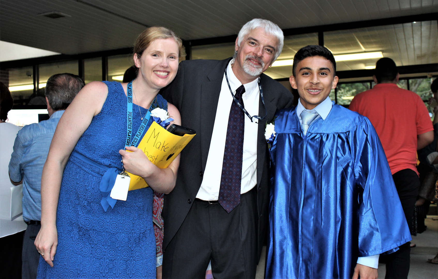 A student poses with two teachers after the ceremony.