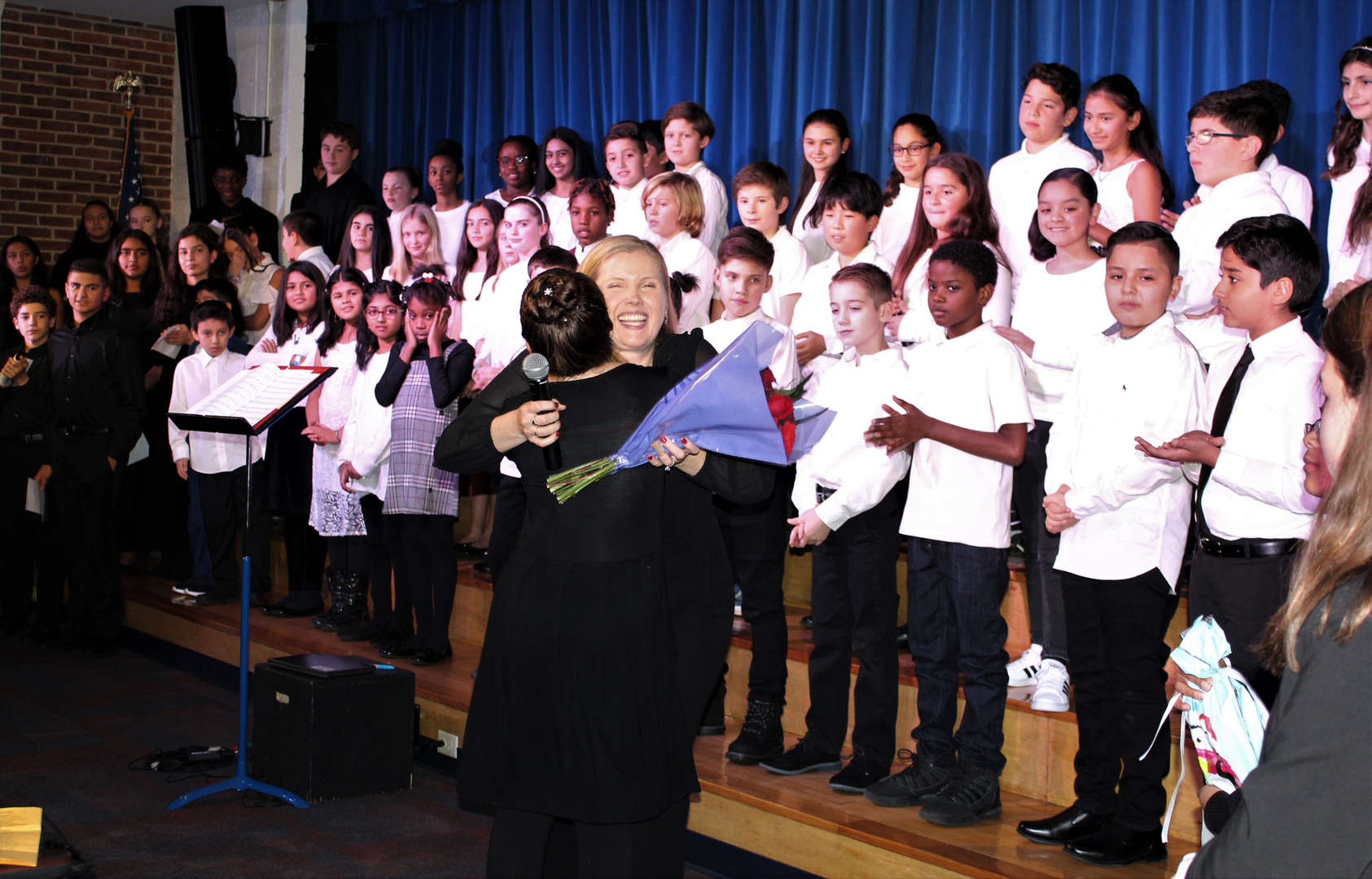 The students thank their teachers, Sheila DePaola and Michael Murray, at the end of the Winter Concert.