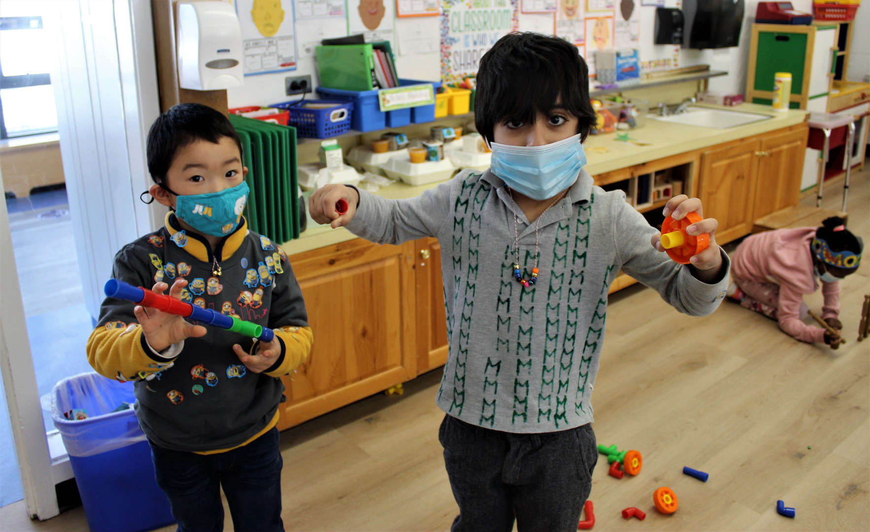 Two kindergarten boys show off their special 100 days of school shirts.