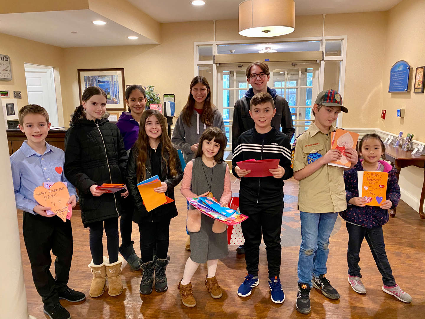 A group of students delivered Valentine's Day cards to a senior home.