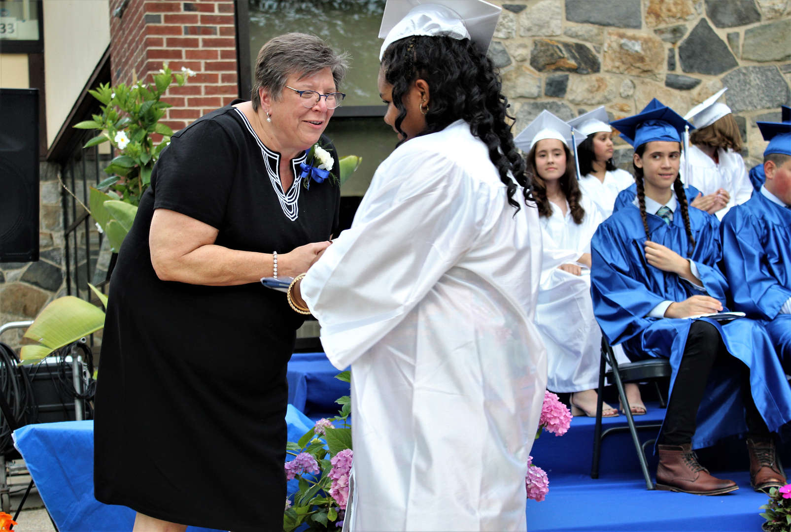 Outgoing Superintendent Carol Conklin-Spillane gave out some of the diplomas at the ceremony.