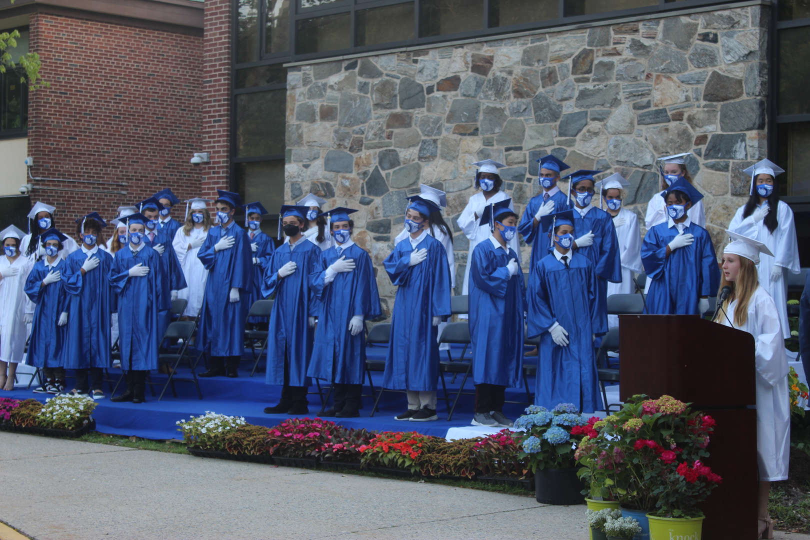 Class of 2021 graduates on stage at graduation.