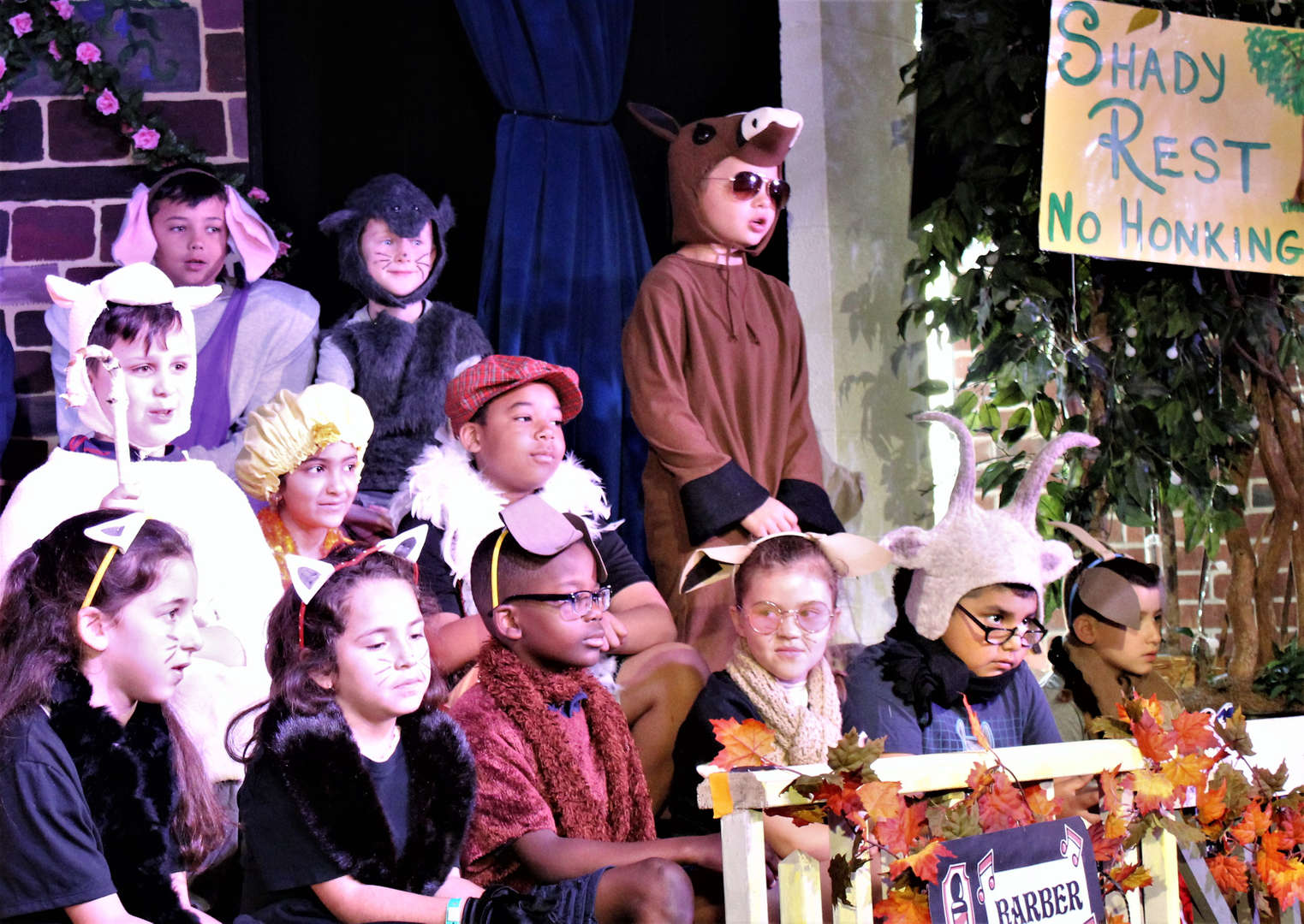 "Children on stage performing ""Charlotte's Web."""