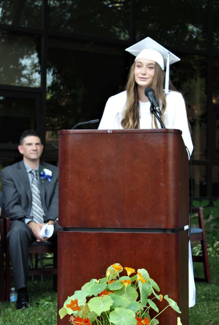 Dylan Zednik, the Harold Akley Award winner, spoke to graduates during the ceremony.