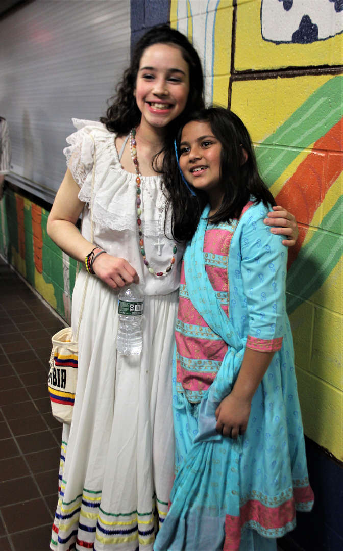 Two students pose for a photo during One World Evening.
