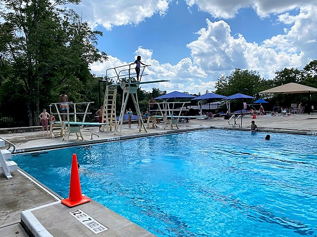 A swimmer prepares to dive into the Pocantico Hills School pool.