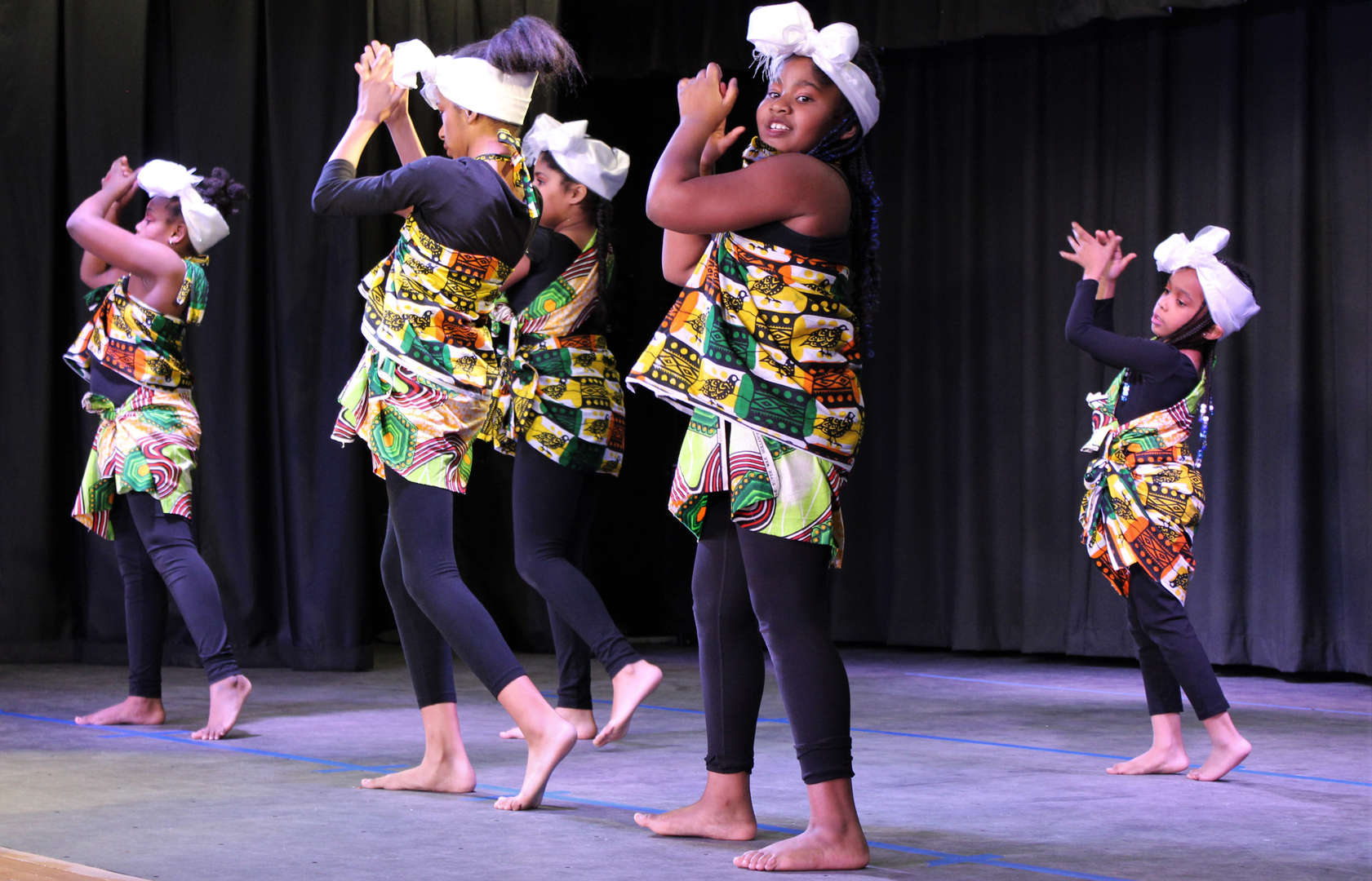 Girls perform African dance during One World Evening.