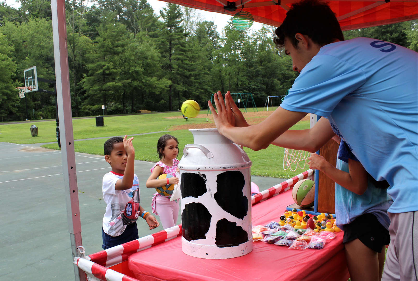 Student playing a carnival game at summer camp.