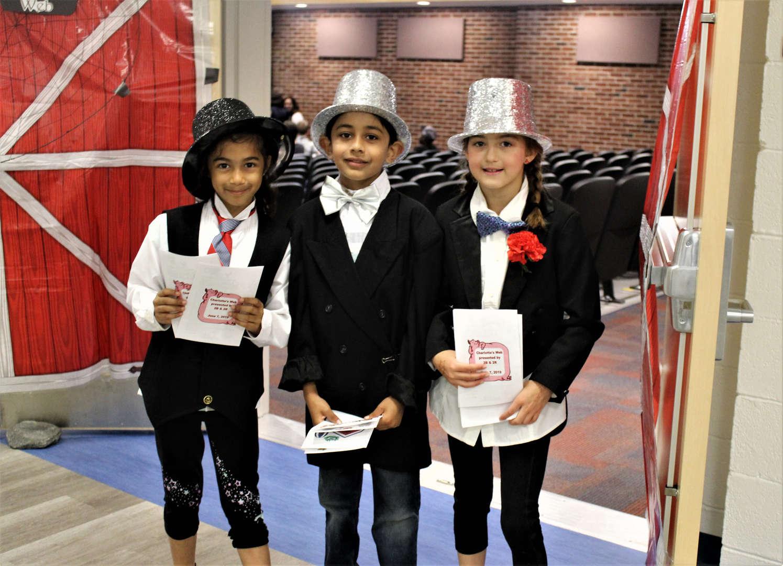 """Children handing out programs for """"Charlotte's Web."""""""