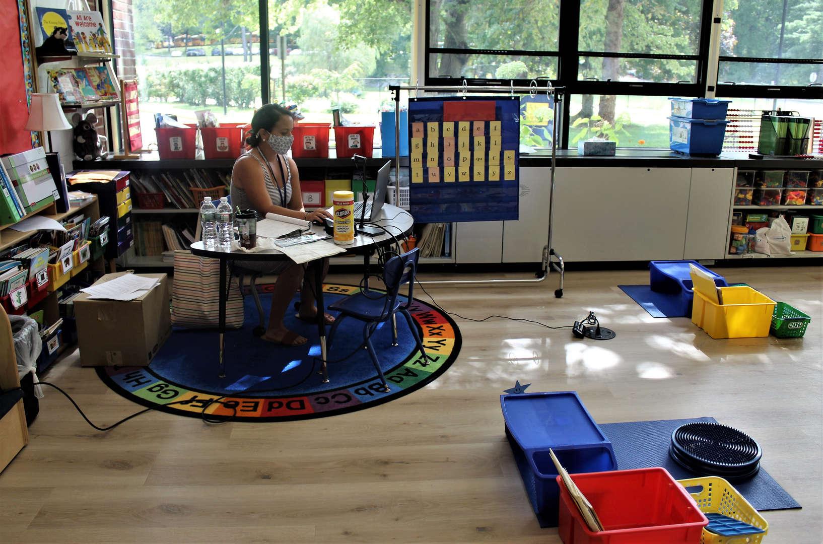 Kindergarten teacher Christina Povemba sets up her classroom for the year.