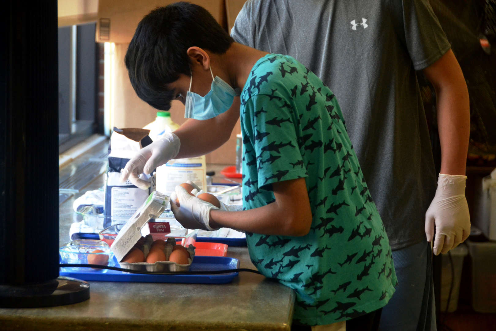 An eighth-grader picks out some eggs to make crepes.
