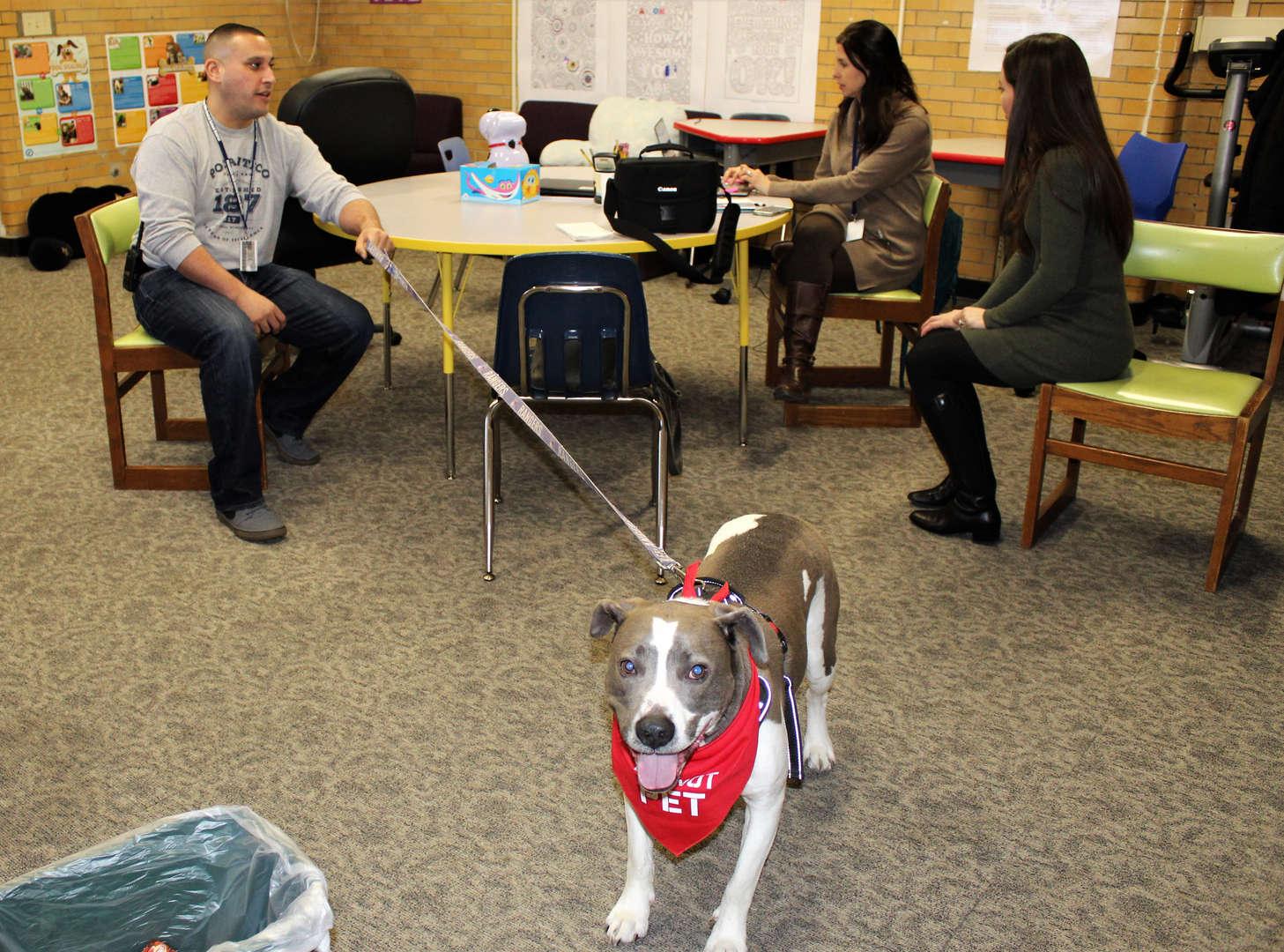 Teacher Mario Suarez and Duke, the school's new therapy dog.