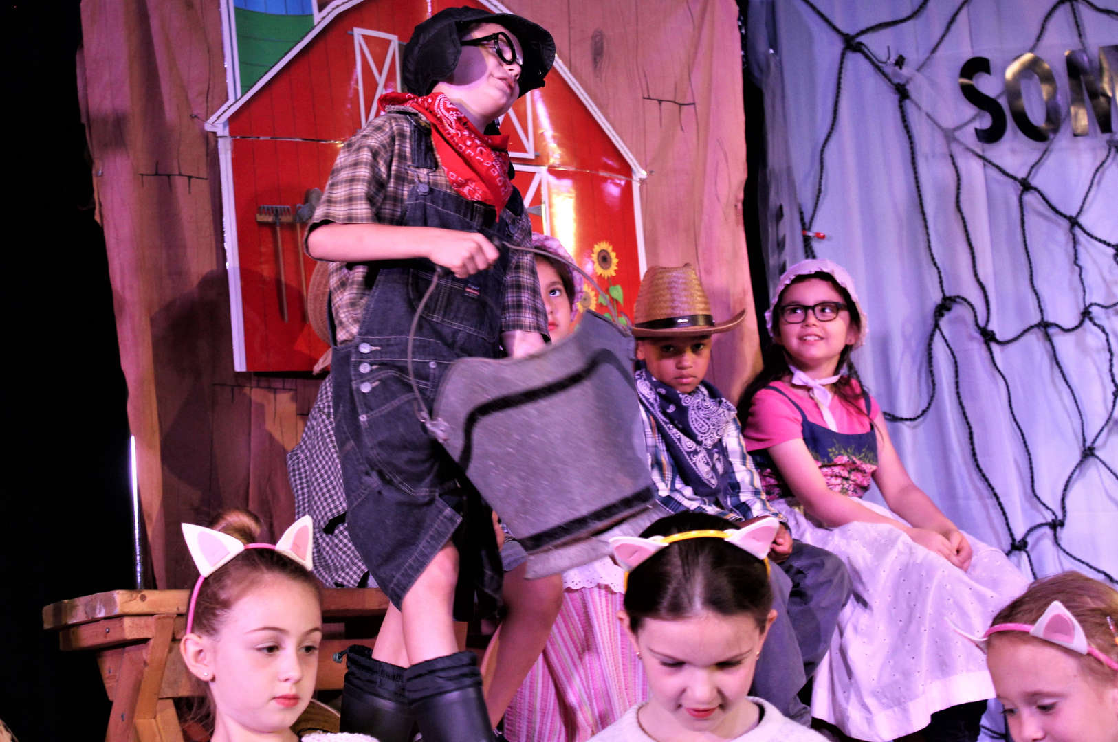 "Students performing ""Charlotte's Web"" on stage."