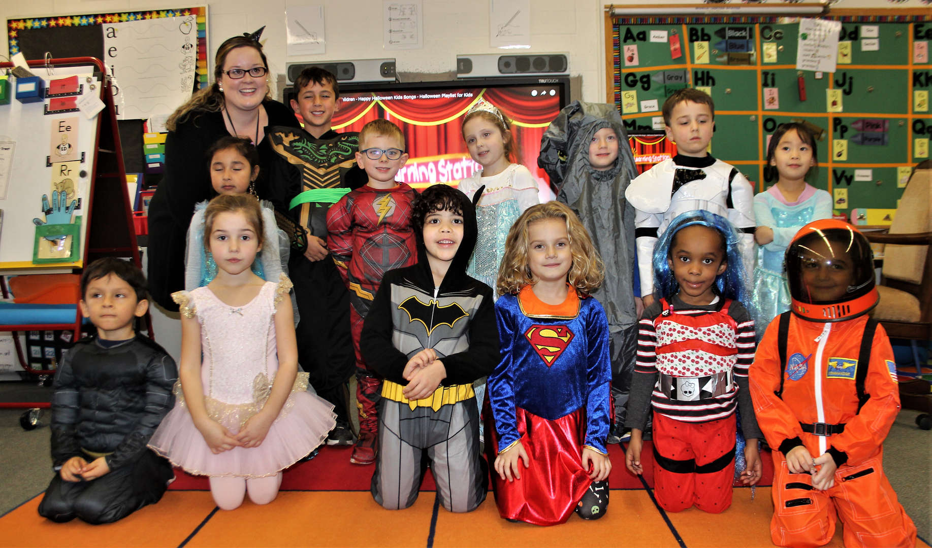Students pose for a class photo on Halloween.