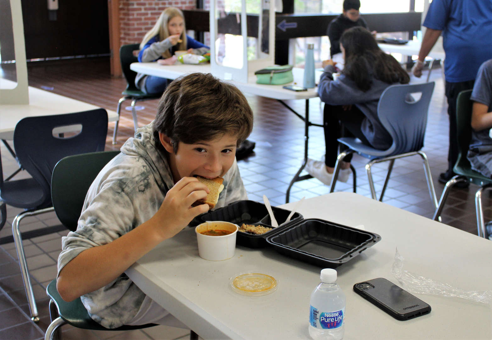 A boy enjoys grilled cheese and vegetable soup on Harvest Soup Day.
