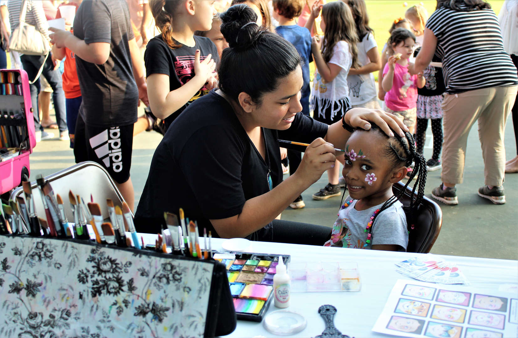 A girl gets her face painted at the PTA Barbecue.