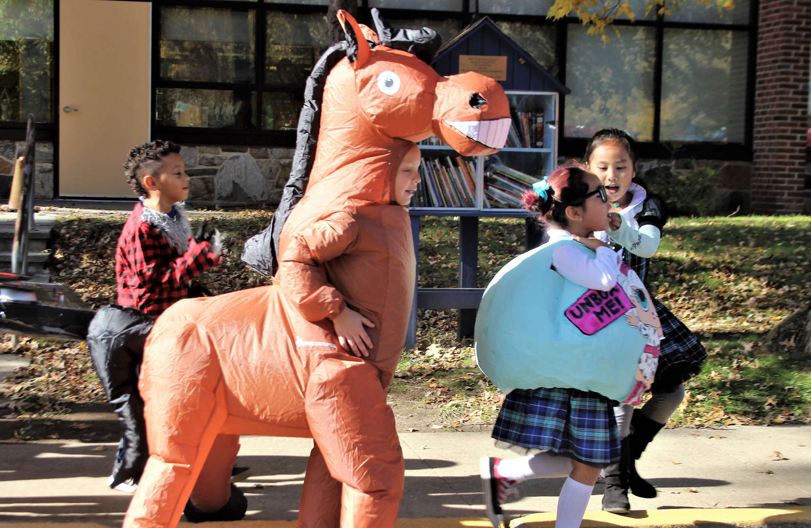 Students walking in the Halloween parade.