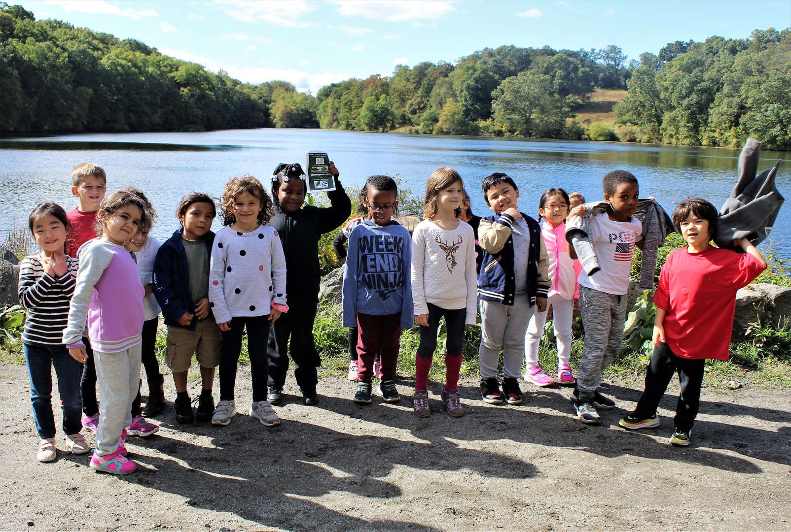 Students pose for a photo during their walk around Swan Lake.