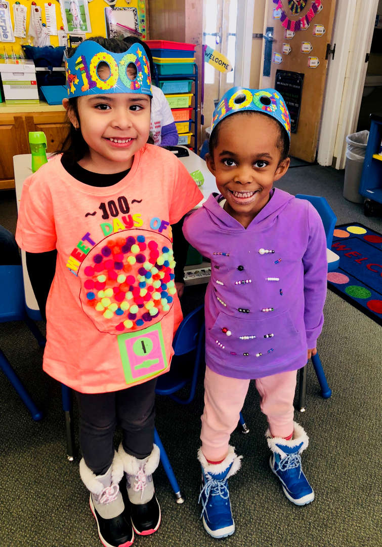 Students are wearing crowns and special T-shirts to celebrate 100 days of school.