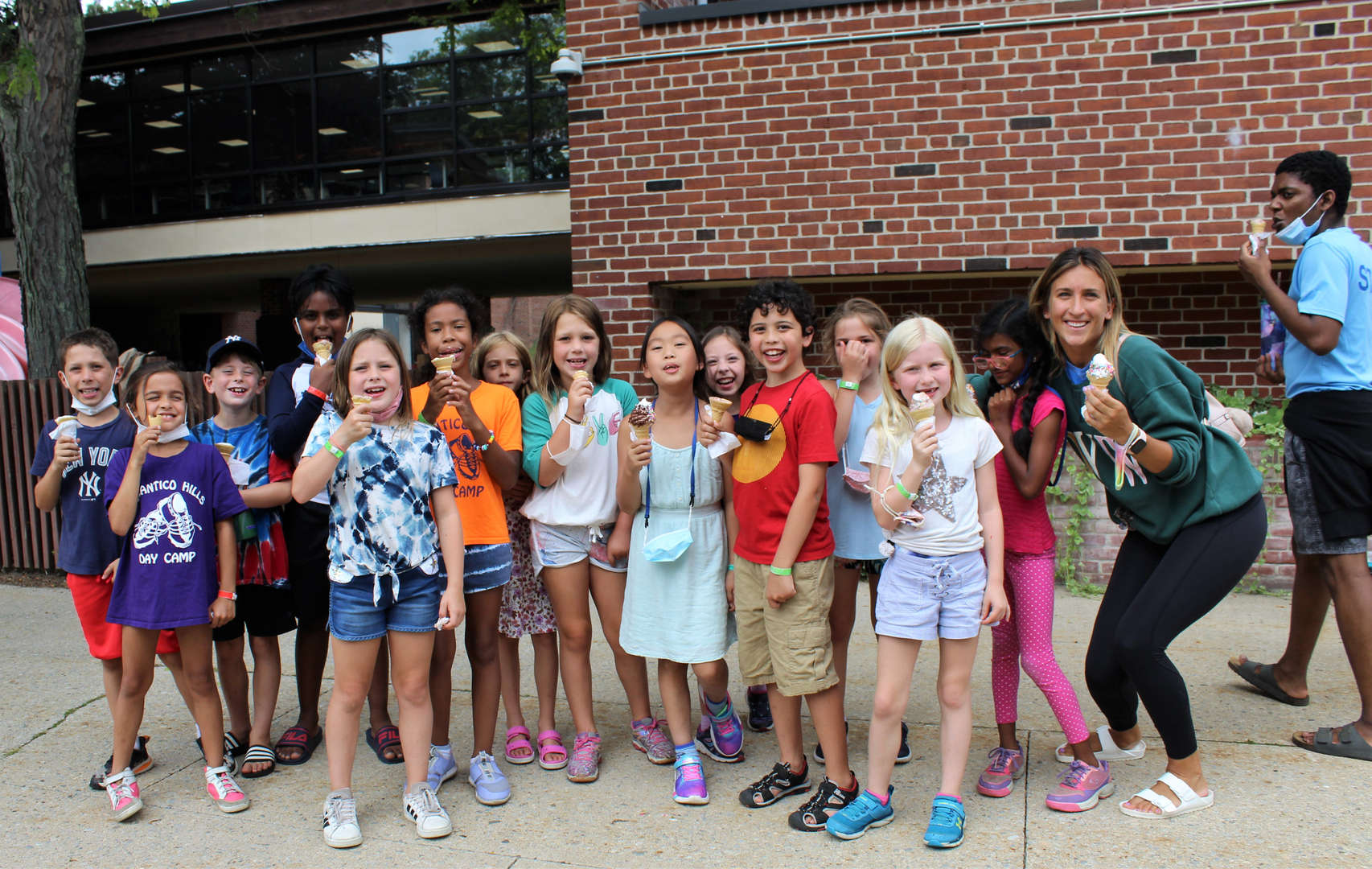 Campers and counselors pose for a photo after visiting the ice cream truck.