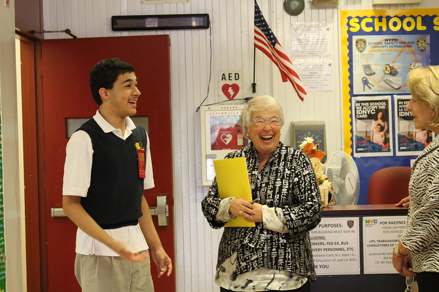 Sharing a hearty laugh with Chancellor Carmen Farina (m.) are M.S. 363's senior, Benny from Class 806 and Sandy Kase, Executive Director of Renewal Schools