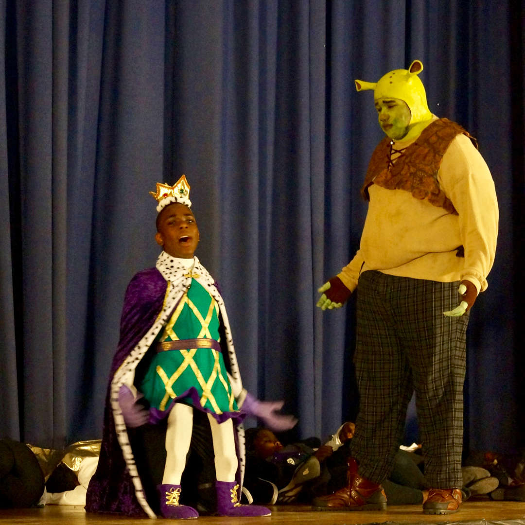 Shrek looking at other character onstage