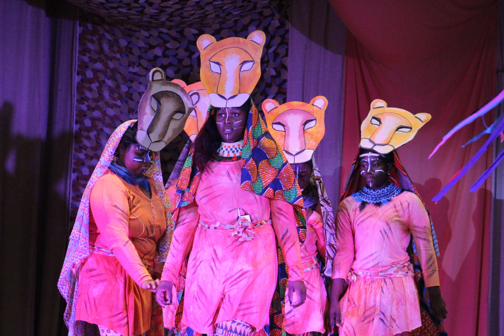 Students with lion masks over heads