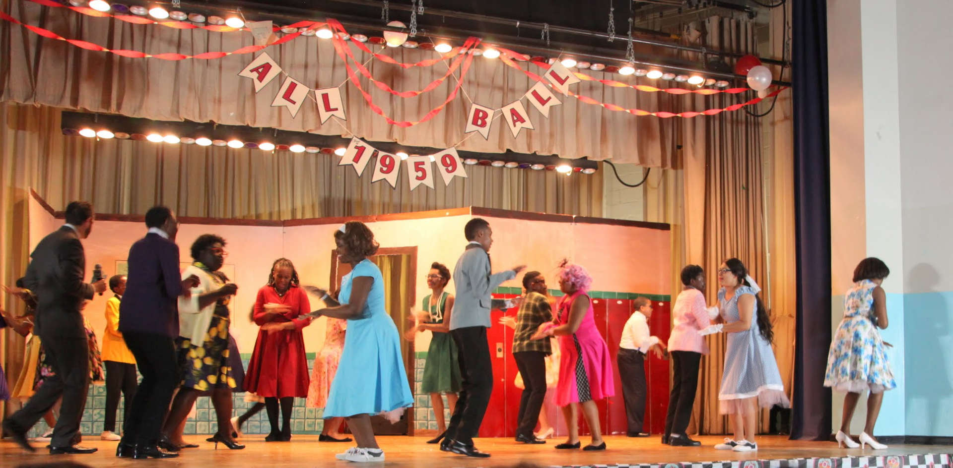 Students dancing on stage together