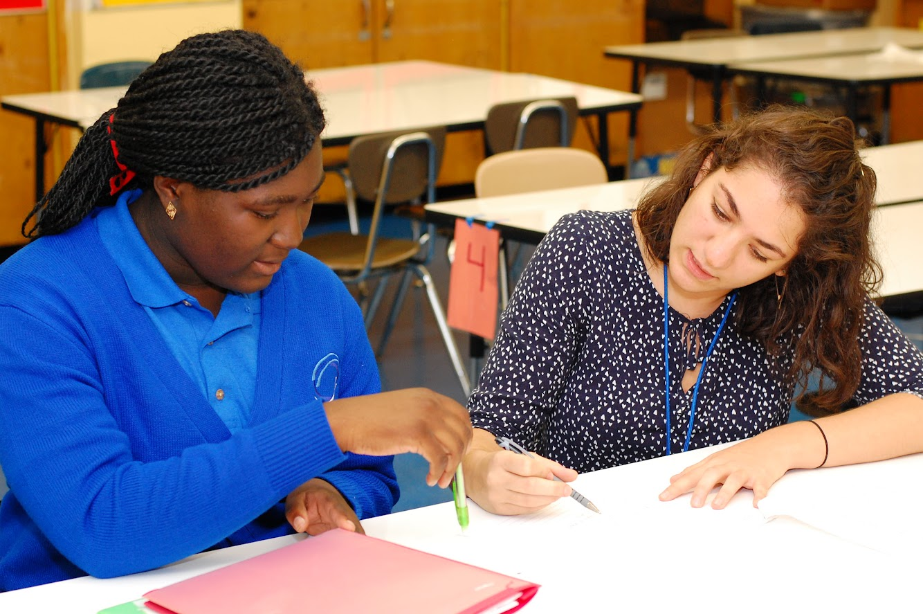 Assistant Principal Rebecca Arsham Helping a Student.