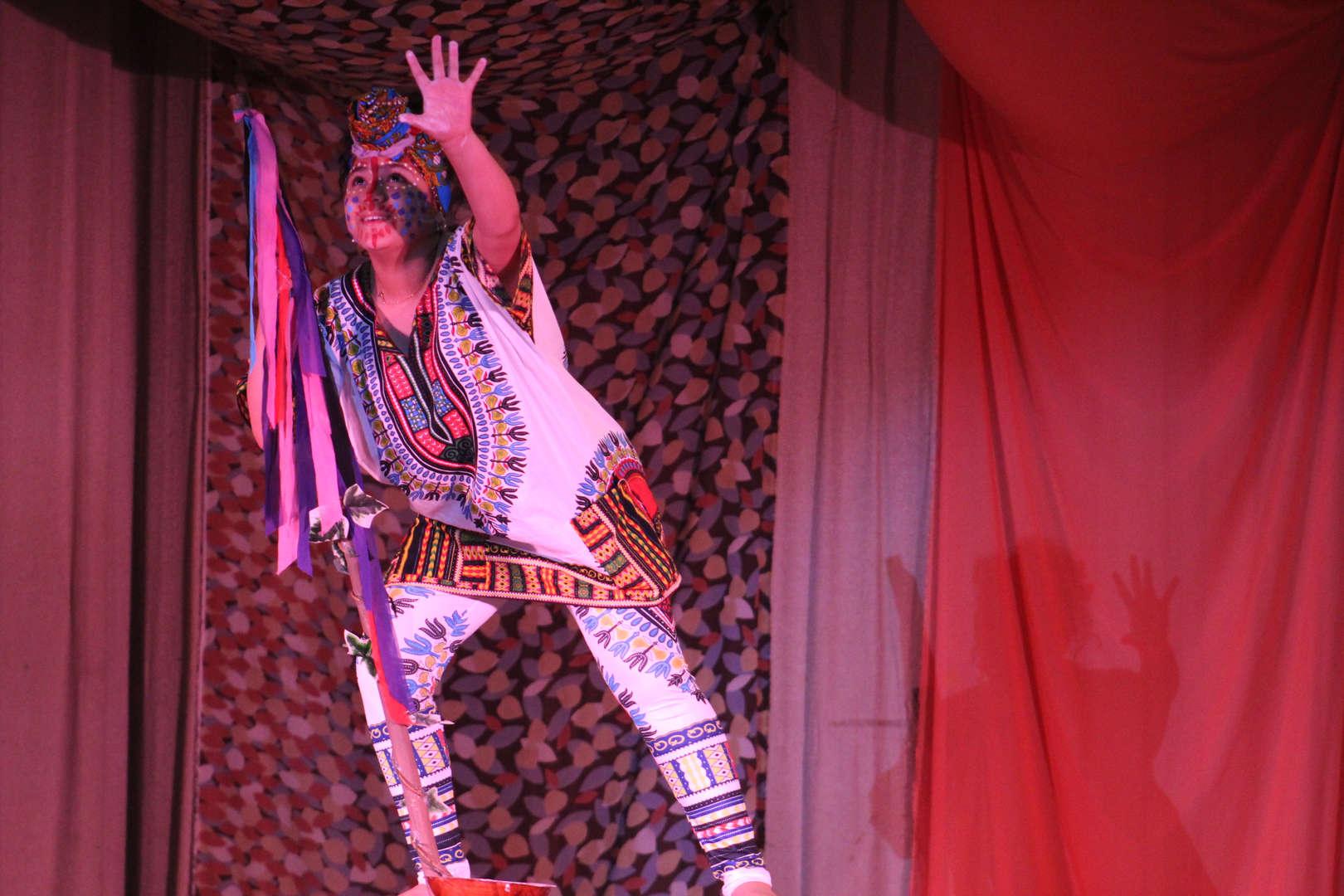 Actor reaching hands up