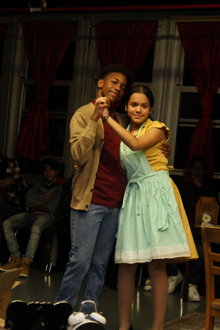 Two actors dance together