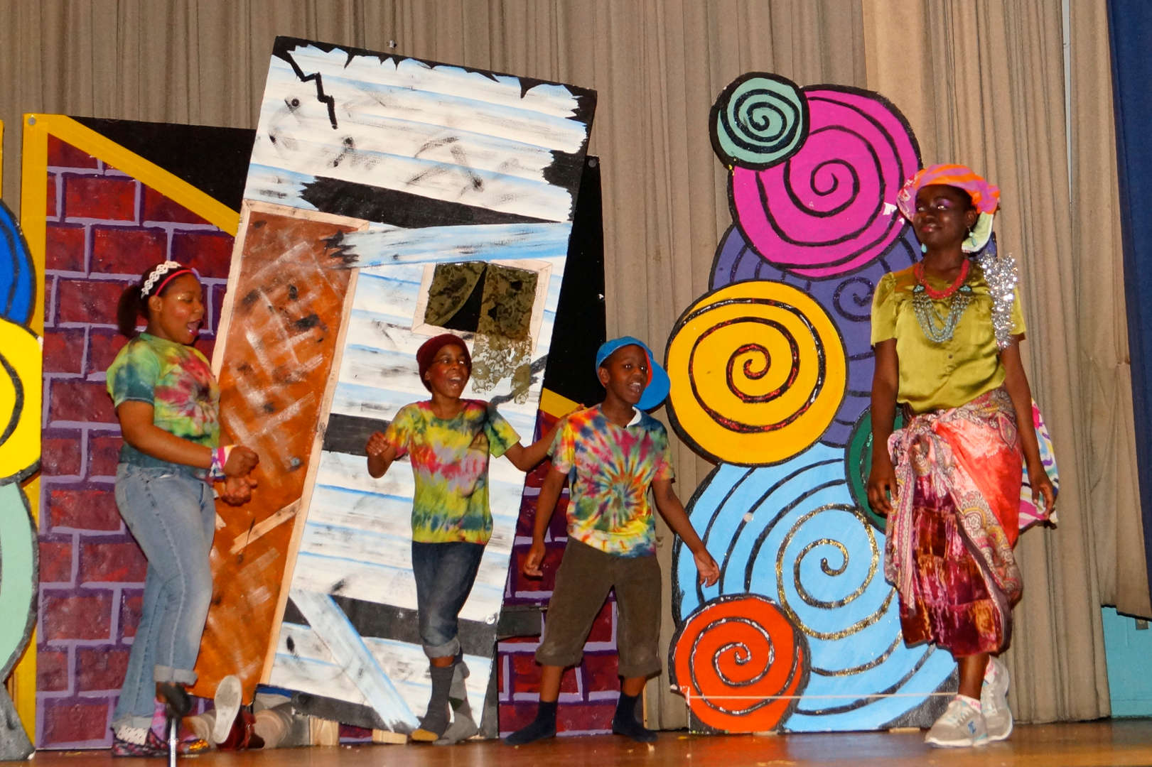 Students dancing together in scene of The Wiz