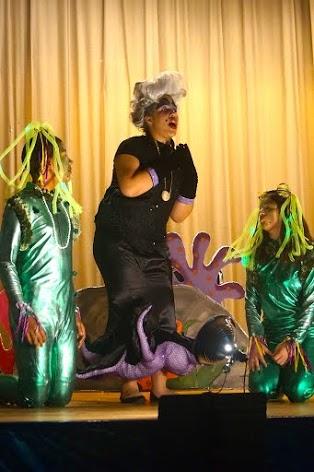 Student dressed as Ursula singing