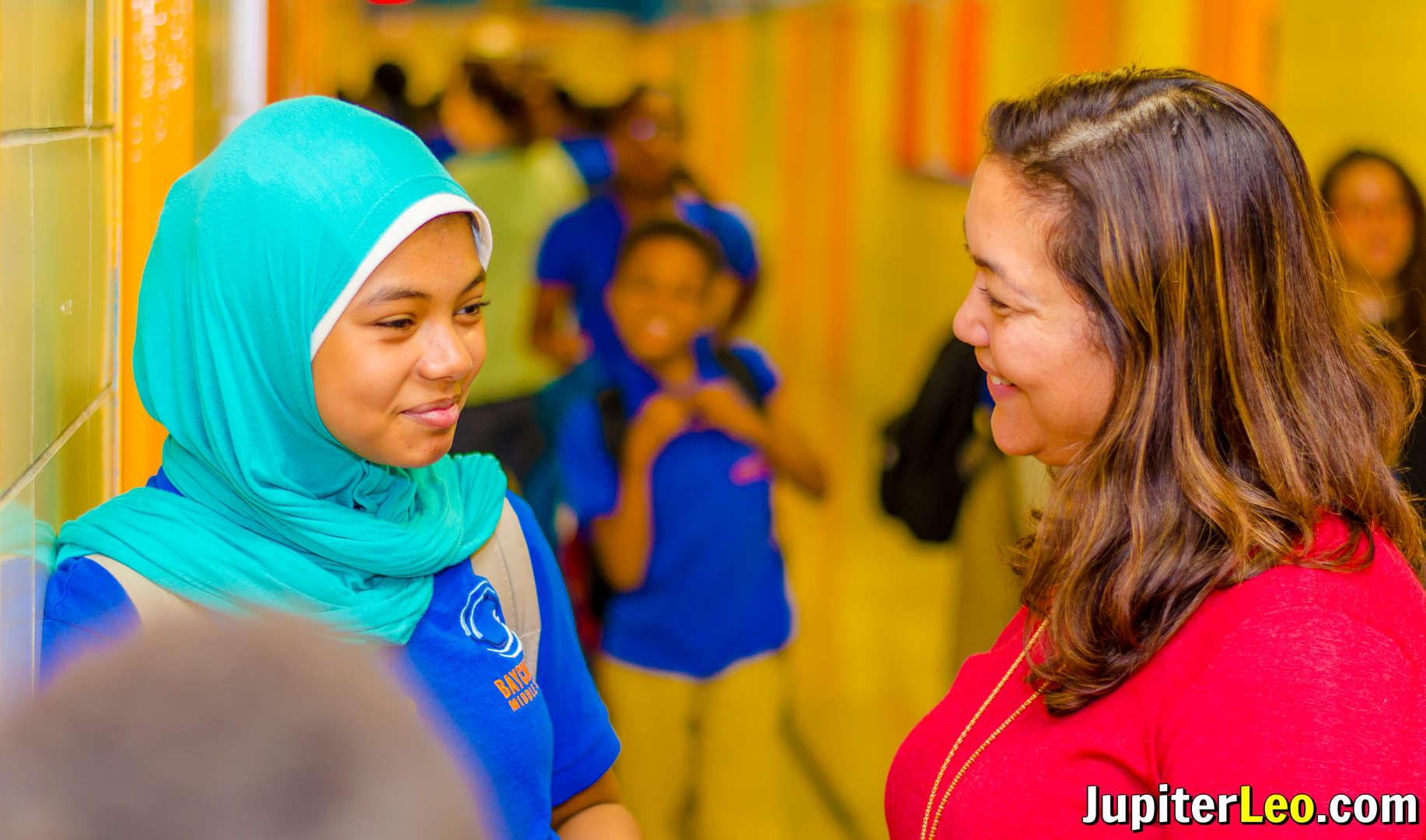 Teacher and student talking to one another