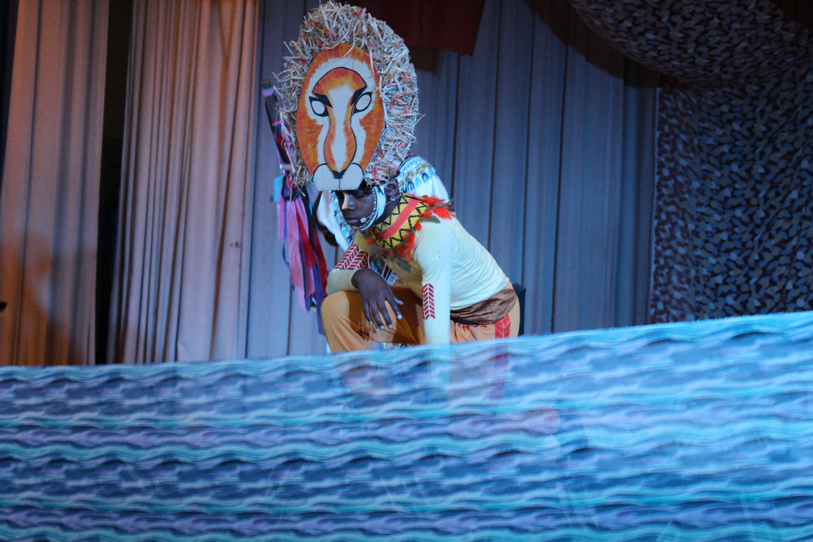 Actor as lion onstage