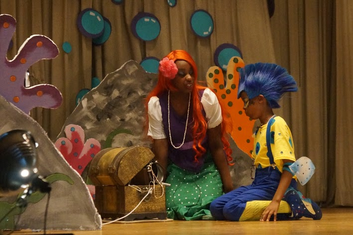 Student dressed as Ariel speaks to another dressed as Flounder