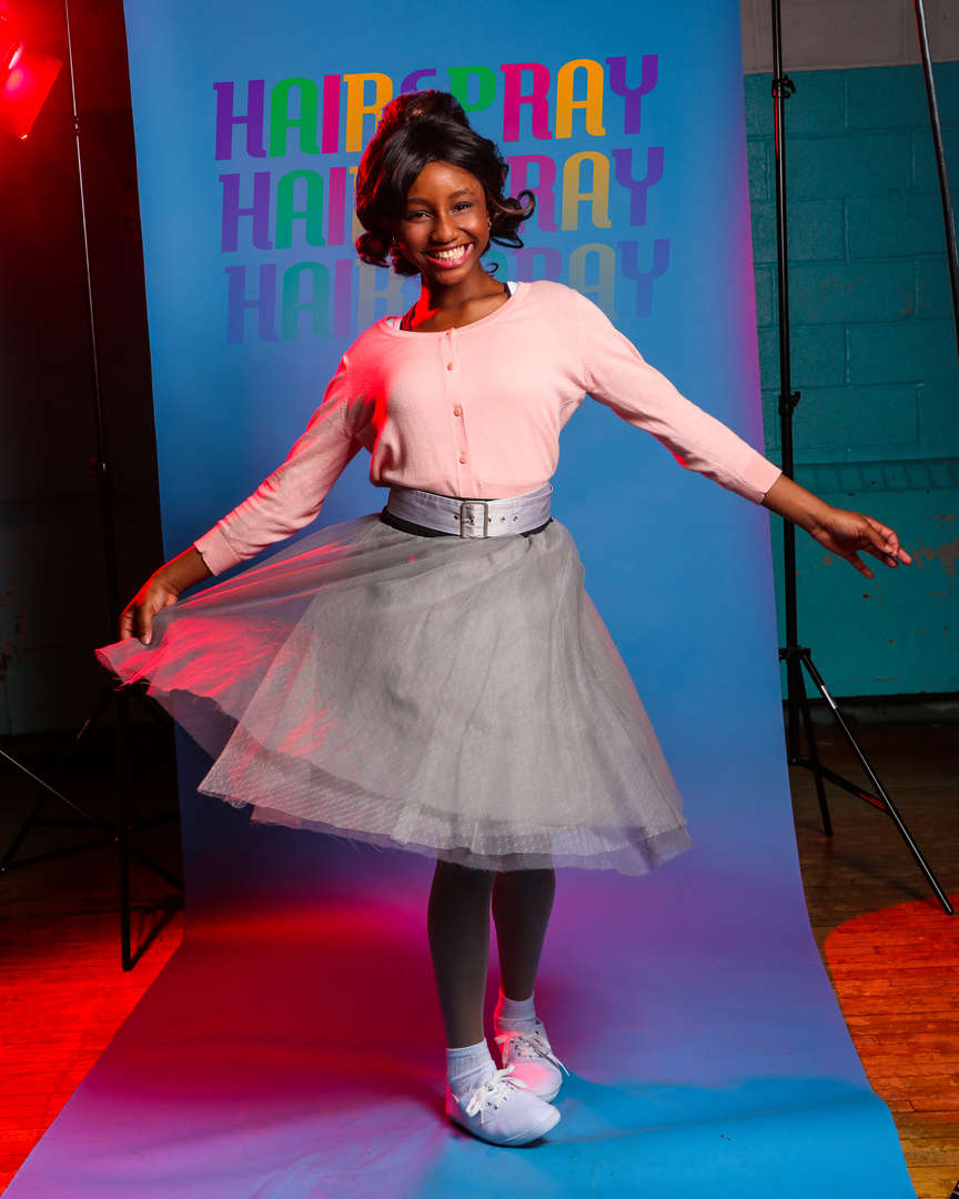 Actor in tulle skirt twirling