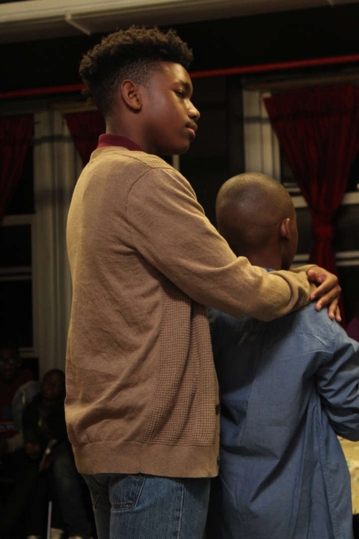 Actor with his arms draped around a younger man