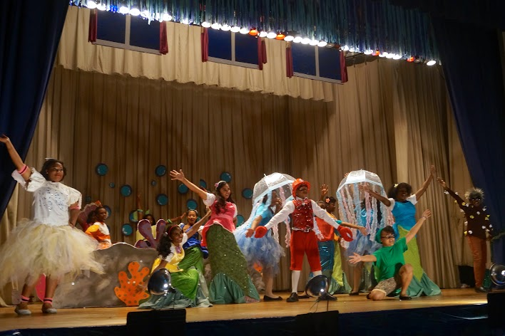 Students dressed as underwater creatures and coral dancing