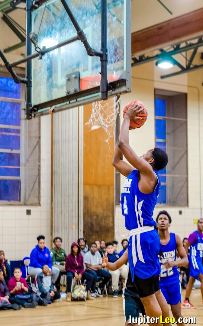 Basketball Player Dunks the Basketball into the Hoop.