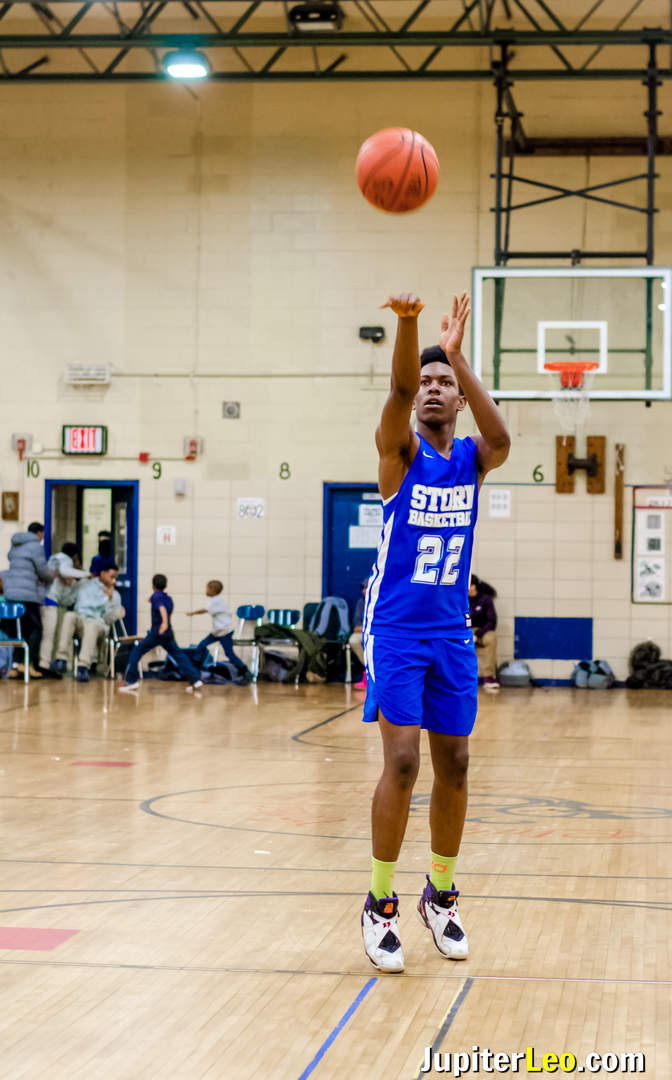Baychester Basketball Player Shoots the Ball at the Basket.