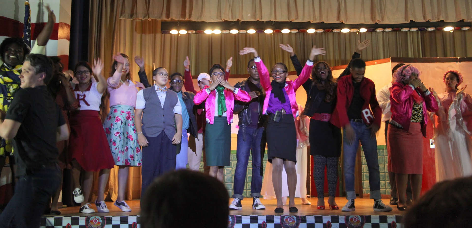Students on stage with one another