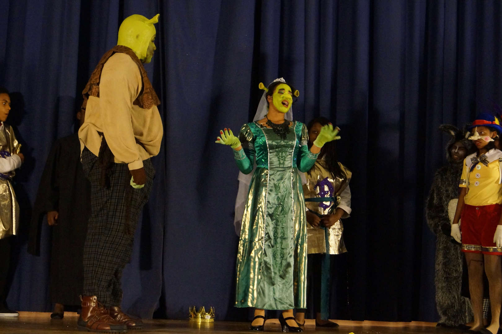 Shrek on stage listening in scene