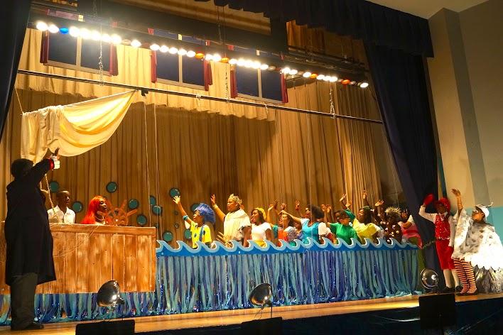 Merfolk singing to Ariel and Prince Eric